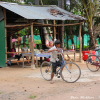 Thumbnail image for Two Kids on Bicycles in a Village in Cambodia