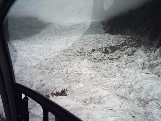 People waiting to be picked up on Fox Glacier
