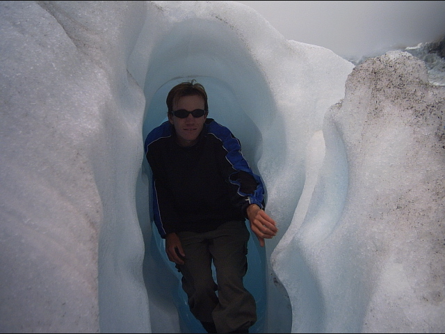 Standing in and ice cave on fox glacier new zealand