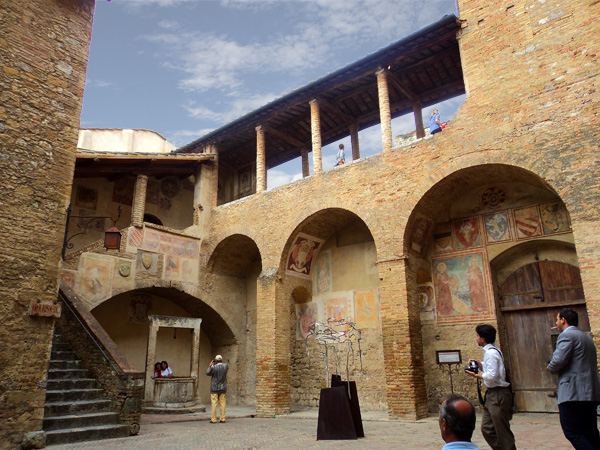 People's palace courtyard in San Gimignano, Italy