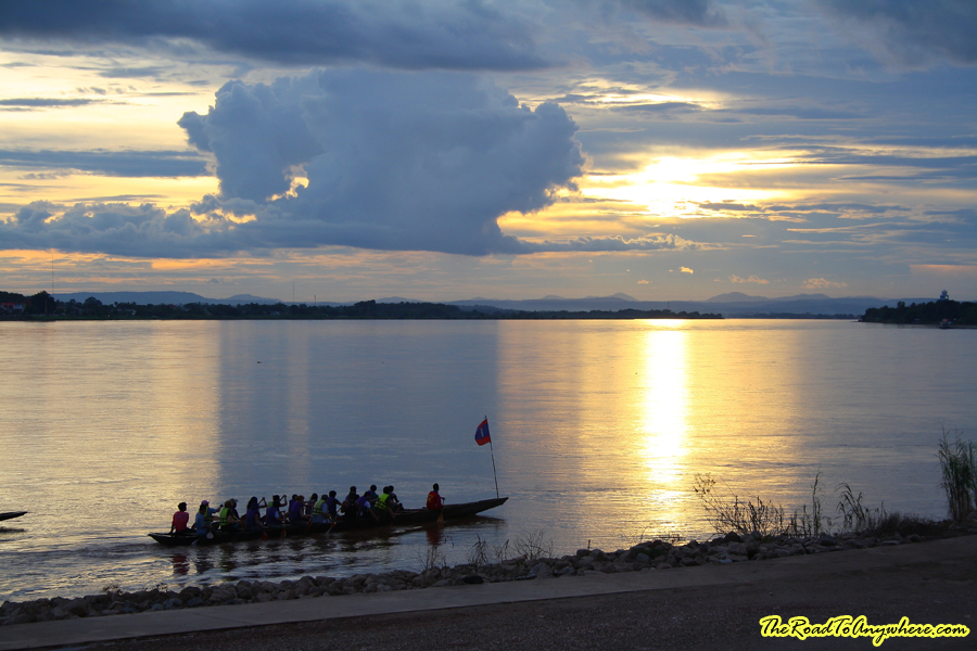 Rowers on the Mekong River at sunset in Vientiane, Laos