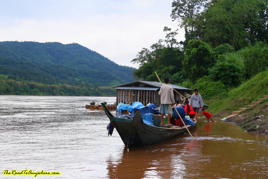 a local boat on the mekong river in Laos