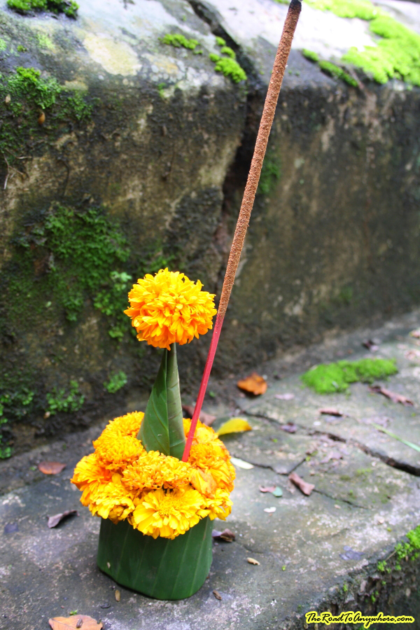 A flower and incense offering at a chedi in Luang Prabang, Laos