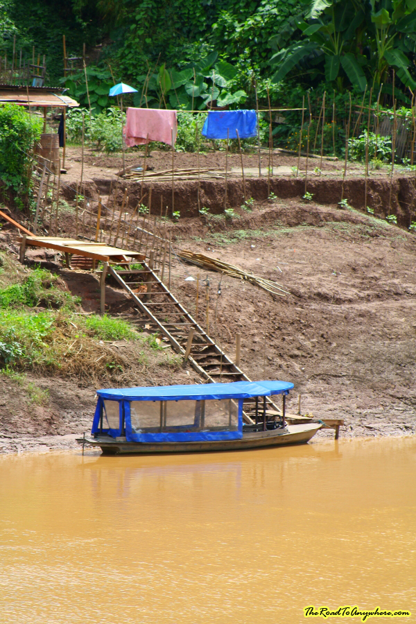 A boat docked at a farm in Luang Prabang, Laos