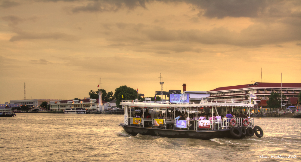 A ferry heads along the Chao Phraya River in Bangkok, Thailand