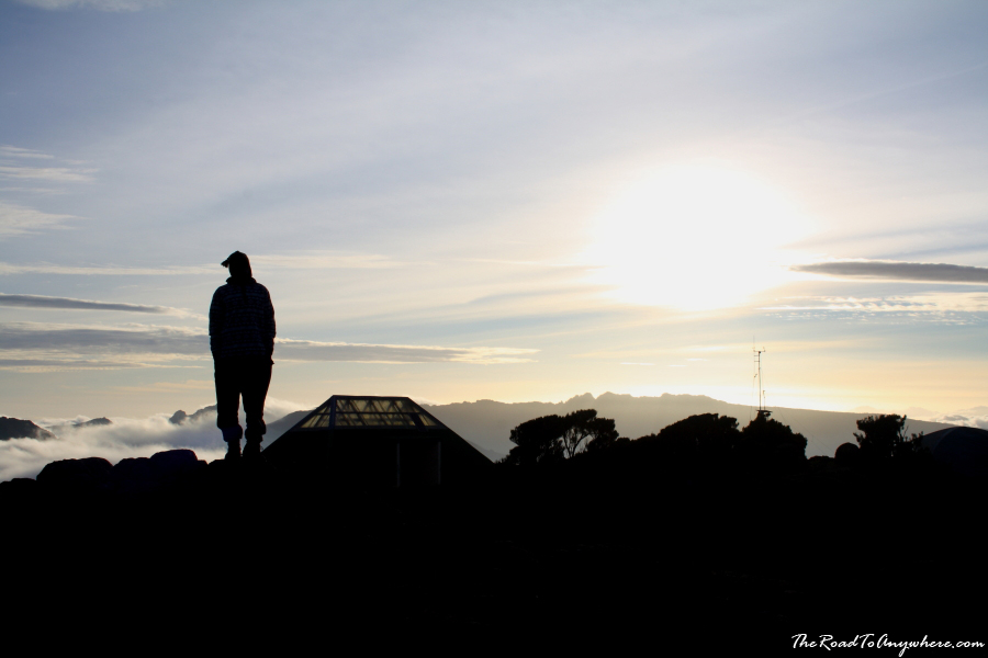 Silhouette of a porter watching the sunset on Mount Kilimanjaro, Tanzania