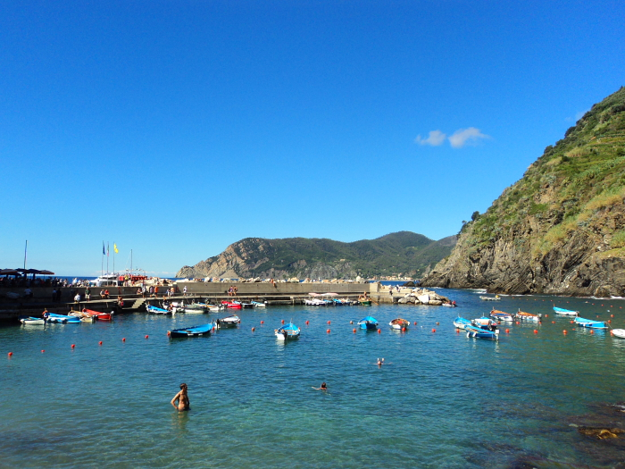 People swimming in the harbour at Vernazza, Cinque Terre, Italy