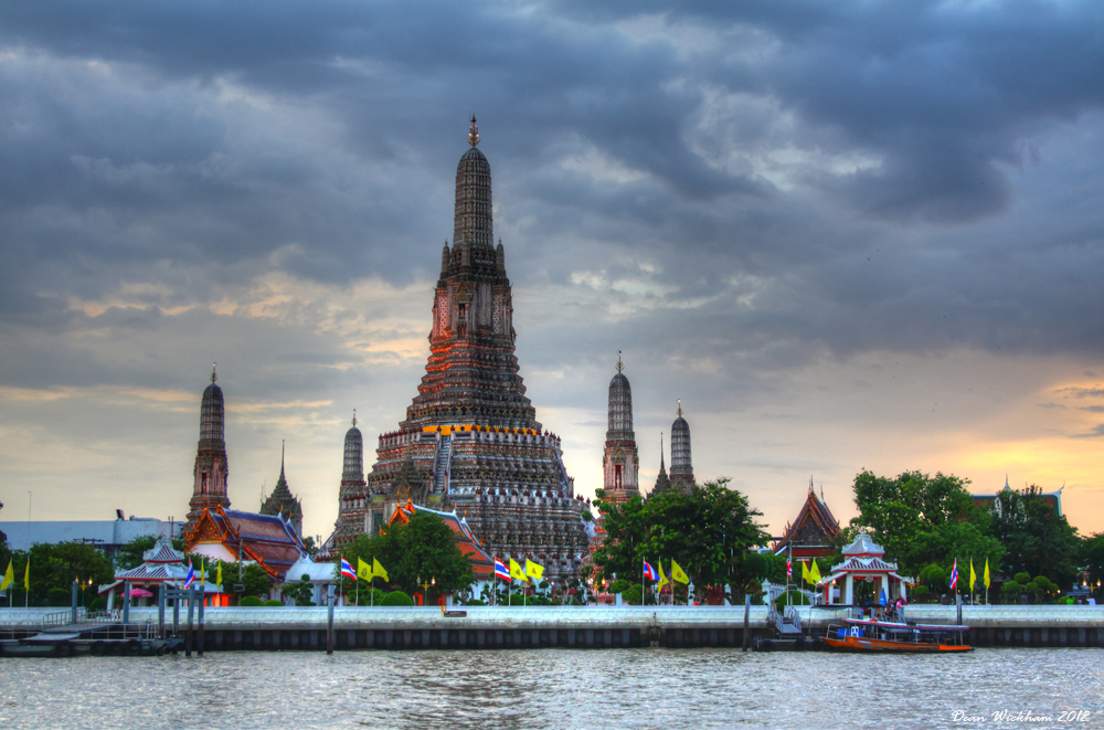 Wat Arun at sunset on the Chao Phraya River in Bangkok, Thailand
