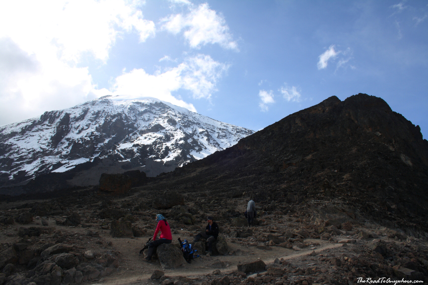 Stopped for a rest with Kibo Peak behind on Mount Kilimanjaro, Tanzania