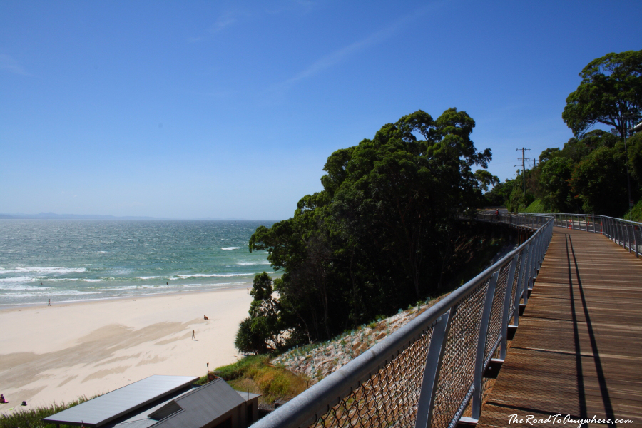 Walking along the boardwalk in Byron Bay, Australia
