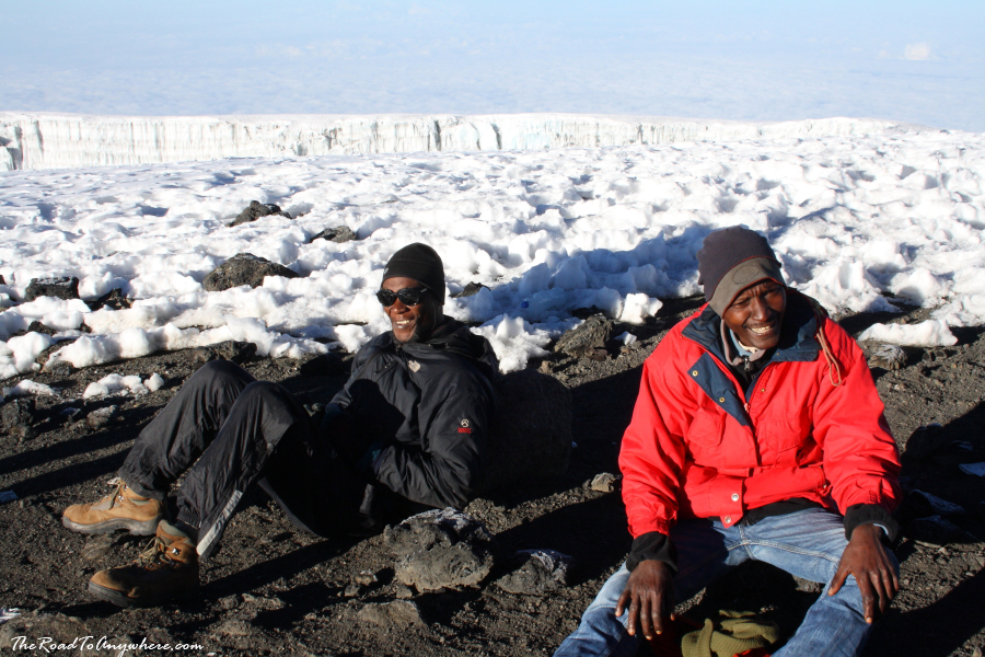 Our guides resting on the summit of Mount Kilimanjaro, Tanzania