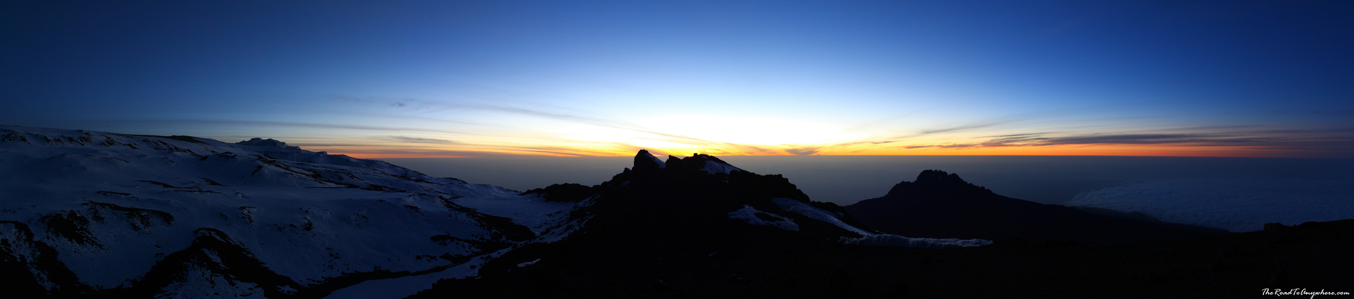 Panoramic view of the sunrise at Stella Point on Mount Kilimanjaro, Tanzania