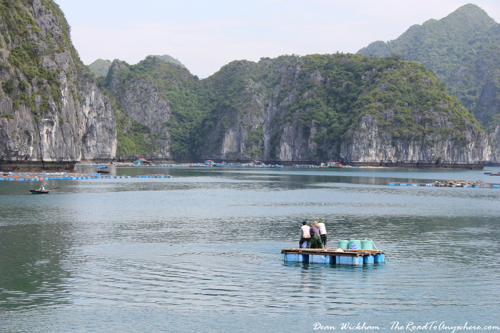 Men working on a pontoon in Han La Bay, Vietnam