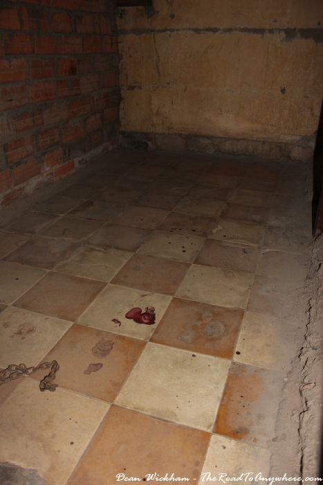 Blood on the floor of a cell at Tuol Sleng Prison in Phnom Penh, Cambodia