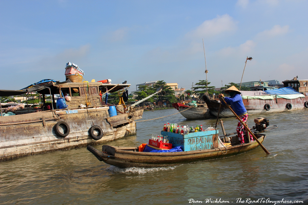 A lady selling cold drinks at Cai Rang Floating Market in the Mekong Delta, Vietnam