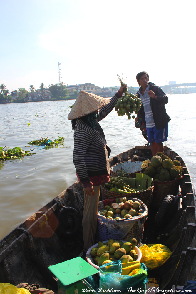 A lady selling fruit at Cai Rang Floating Market in the Mekong Delta, Vietnam