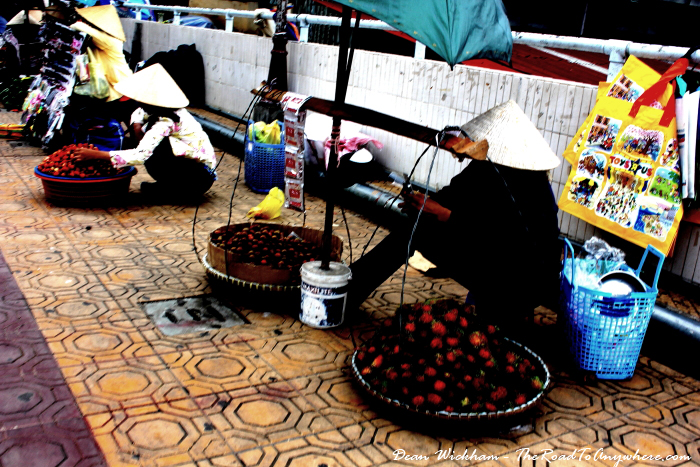 Lady selling rambutans in Dalat, Vietnam