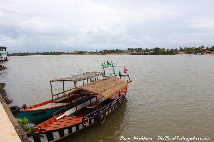 Boats on the river in Kampot, Cambodia