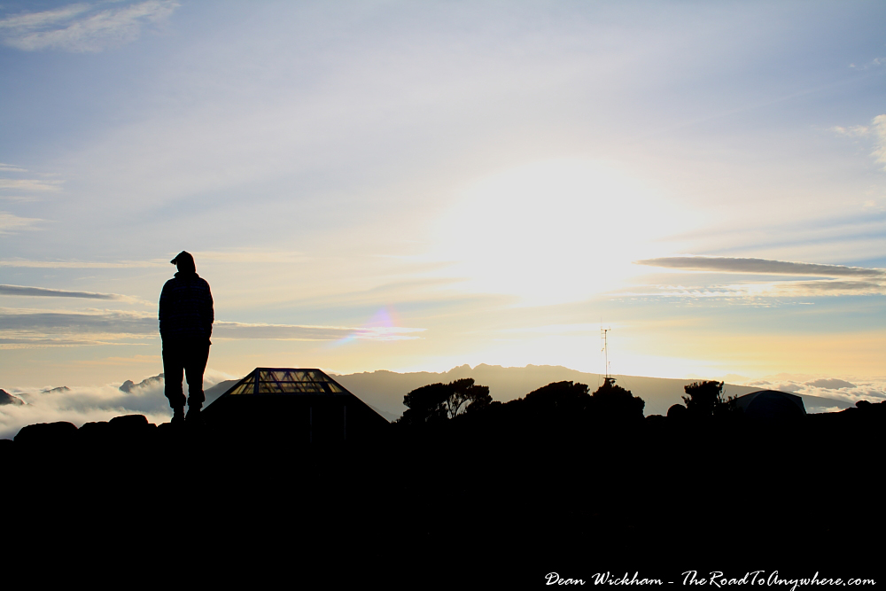 Silhouette of a porter watching the sunset at Shira Plateau on Mount Kilimanjaro, Tanzania