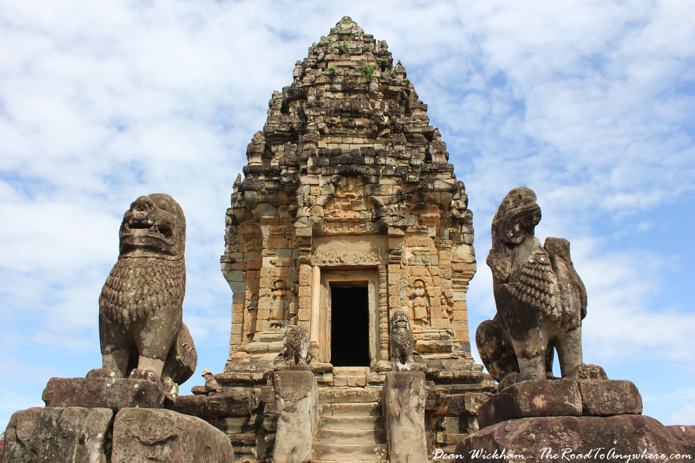 Statues and central tower in Bakong in Angkor, Cambodia