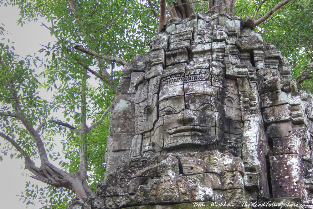 Ancient stone face at Ta Som in Angkor, Cambodia