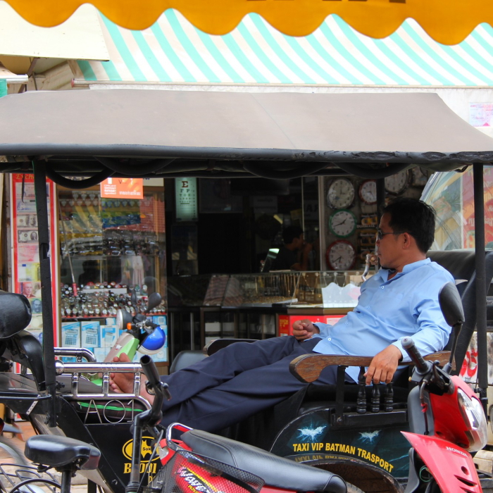 Tuk tuk driver waiting for a fare in Siem Reap, Cambodia