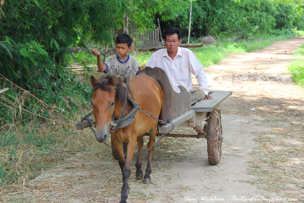 Father and son on a horse and cart on Koh Trong, Cambodia