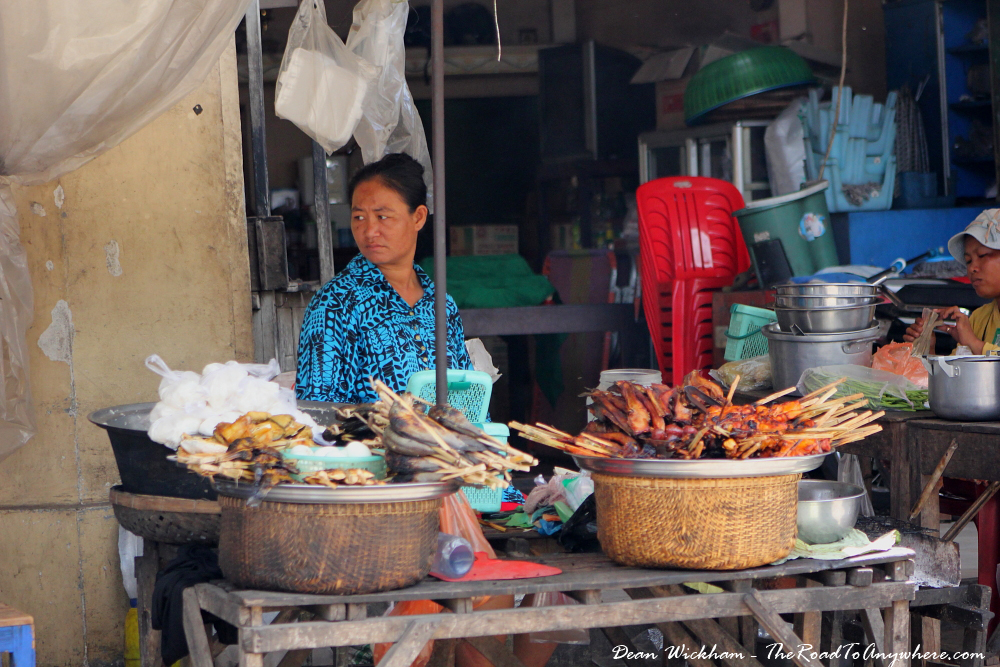 Lady selling grilled meat skewers in Kampong Cham, Cambodia