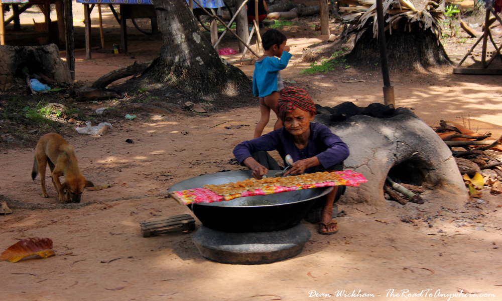 Old lady cooking in a village in Cambodia