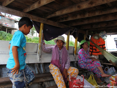 People on a boat in Kratie, Cambodia