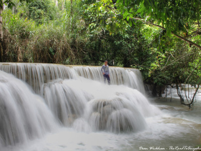 Standing on a cascade at Kuang Si, Laos