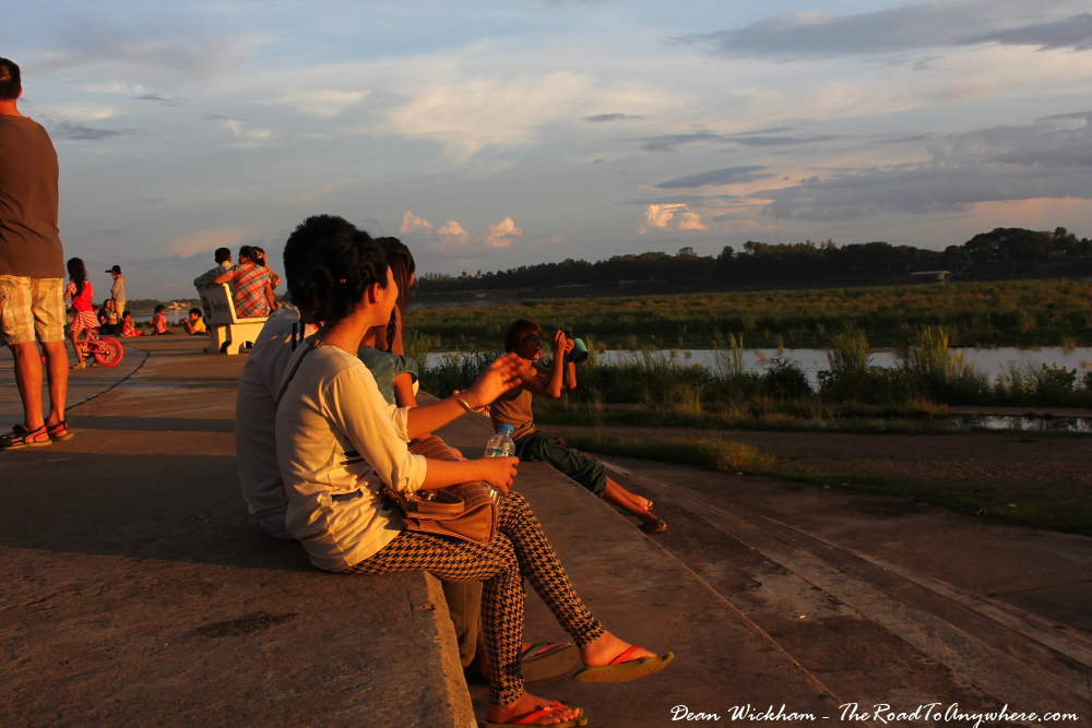 Young couple watching the sunset in Vientiane, Laos