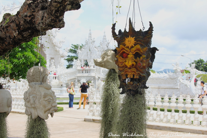 Heads hanging from a tree at Wat Rong Khun (The White Temple) in Chiang Rai, Thailand