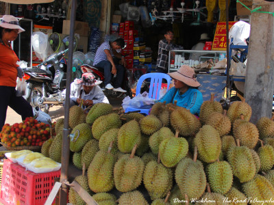 People selling durians on the street in Kampong Cham, Cambodia