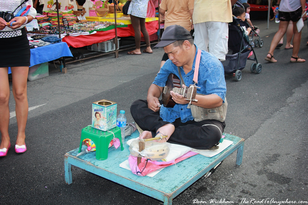 Busker at the Sunday Market in Chiang Mai, Thailand