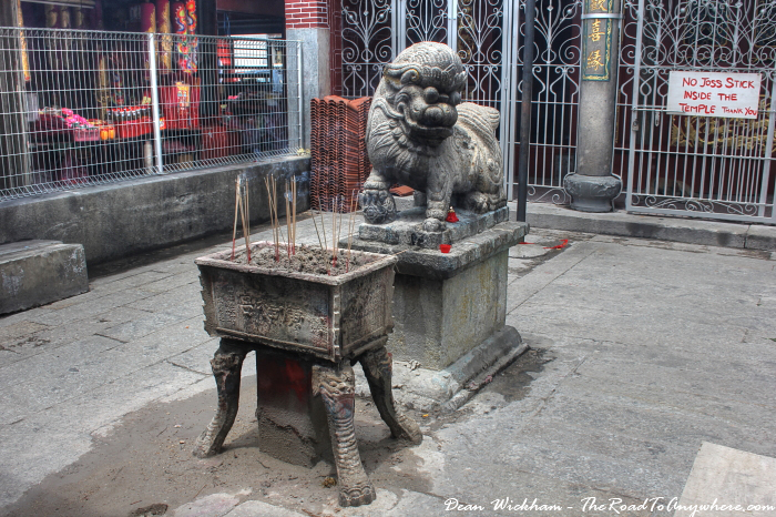 Statue and incense at Goddess of Mercy Temple in Penang, Malaysia