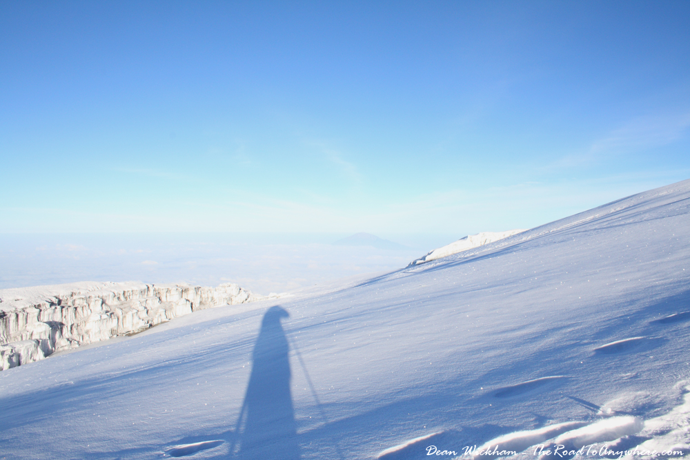 My shadow on the snow at the summit of Mount Kilimanjaro